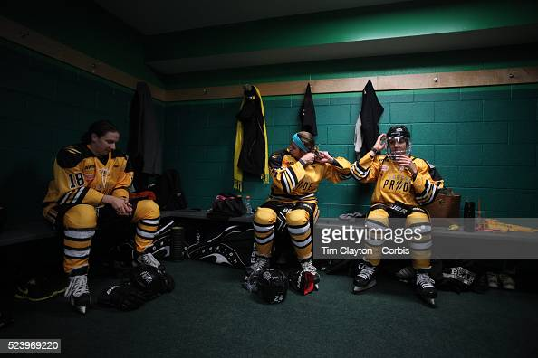 Boston Pride players from left Cherie Hendrickson Denna Laing and Hayley Moore prepare for the game in the dressing room before the Connecticut Whale...