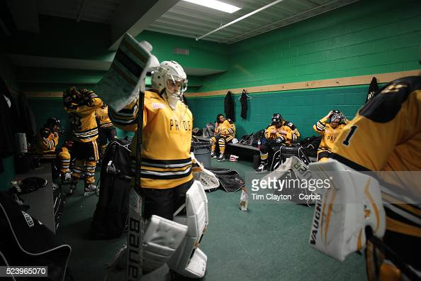 Boston Pride players prepare for the game in the dressing room before the Connecticut Whale vs Boston Pride National Women's Hockey League game at...