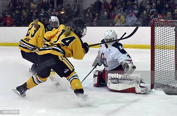 Boston Pride's forward Brianna Decker scores against New York Riveters during their game of the first season of the National Womens Hockey League at...