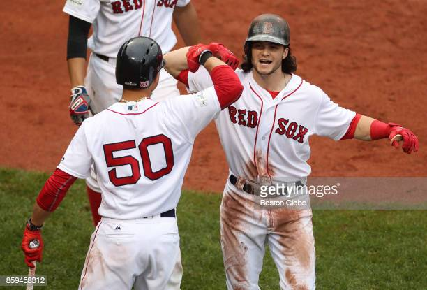 Boston Red Sox Andrew Benintendi celebrates his tworun home run with Mookie Betts in the fifth inning The Boston Red Sox host the Houston Astros in...