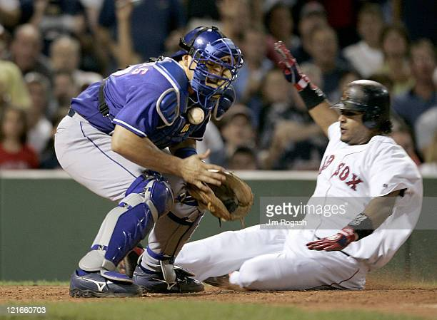 Boston Red Sox base runner Manny Ramirez right scores as Texas Rangers catcher Rod Barajas loses control of the ball Friday July 9 2004 The Red Sox...