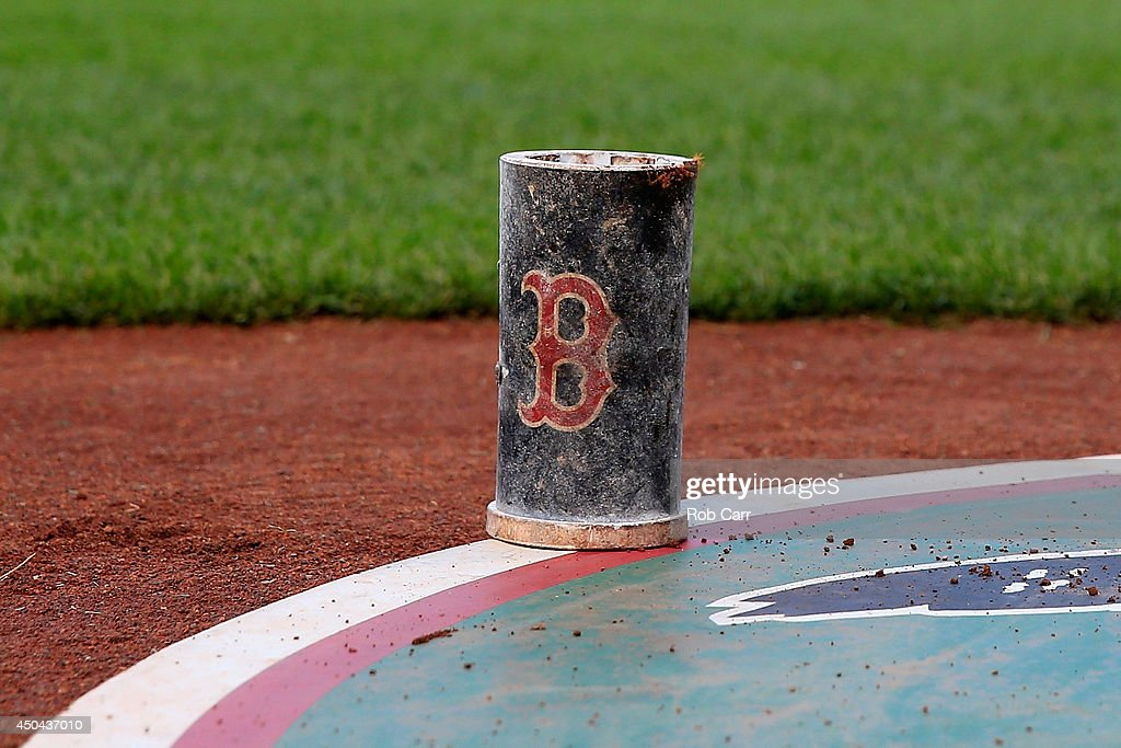 A Boston Red Sox bat weight sits on the ground during the Red Sox and Baltimore Orioles game at Oriole Park at Camden Yards on June 9, 2014 in Baltimore, Maryland.