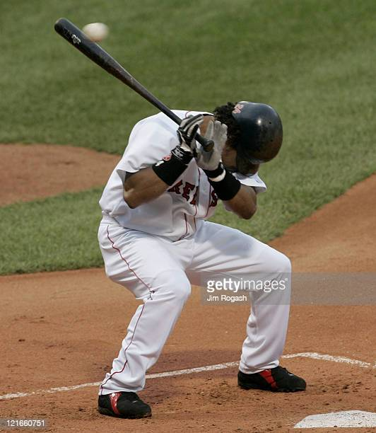 Boston Red Sox batter Manny Ramirez ducks from a wild pitch in a game against the Oakland Athletics at Fenway Park in Boston July 8 2004 The Red Sox...