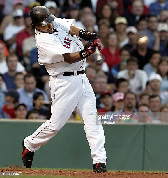 Boston Red Sox batter Manny Ramirez makes contact against the Texas Rangers Friday July 9 2004 The Red Sox won 70 at Fenway Park in Boston