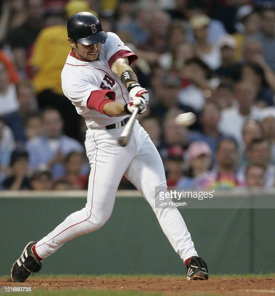 Boston Red Sox batter Nomar Garciaparra makes contact against the Texas Rangers Friday July 9 2004 The Red Sox won 70 at Fenway Park in Boston