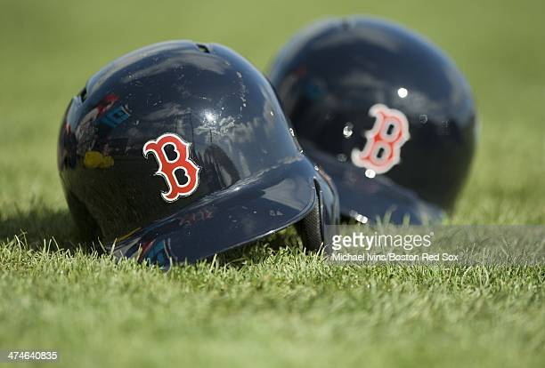 Boston Red Sox batting helmets sit in the grass during a Spring Training workout at Fenway South on February 24 2014 in Fort Myers Florida
