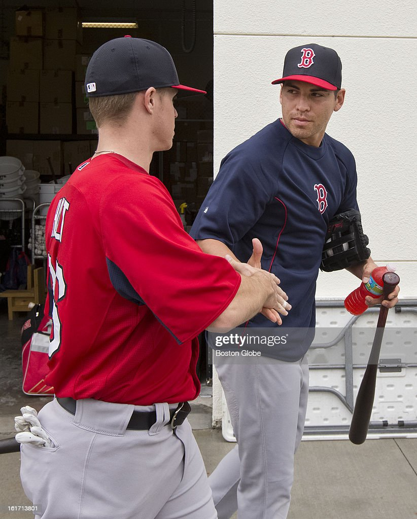 Boston Red Sox Brock Holt, left introduces himself to teammate Jacoby Ellsbury as they walk to the covered batting cage. Day three of spring training at the Red Sox training facilities at JetBlue Park on Thursday, Feb. 14, 2013.