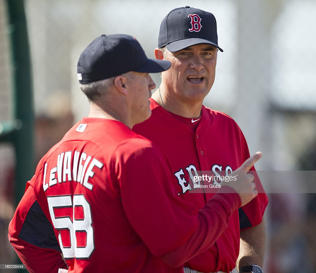 Boston Red Sox bull pen coach Dana Levangie talks to manager John Farrell during spring training at JetBlue Park on Tuesday, Feb. 19, 2013.