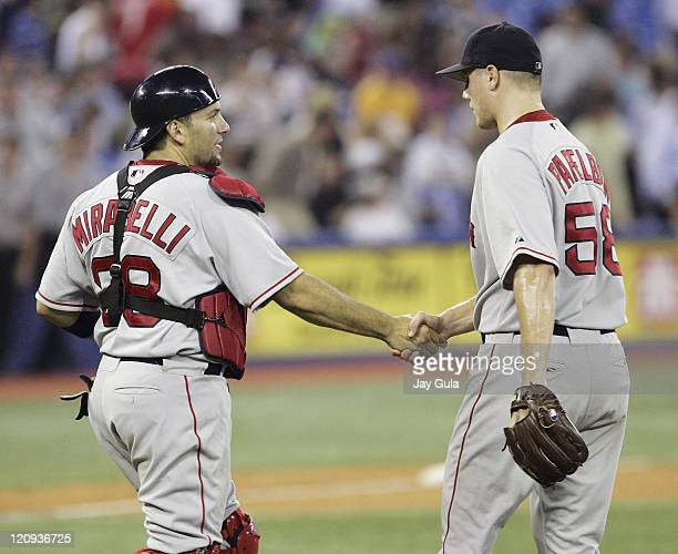 Boston Red Sox C Doug Mirabelli and P Jonathan Papelbon shake hands after the Red Sox defeated the Toronto Blue Jays 86 at Rogers Centre in Toronto...