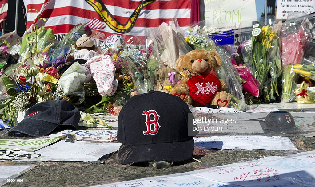 A Boston Red Sox cap left at a makeshift memorial on the Boston Marathon route April 18 2013 in Boston No arrests have been made in connection with...