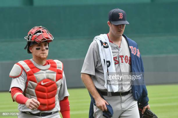 Boston Red Sox catcher Christian Vazquez and Boston Red Sox starting pitcher Drew Pomeranz enter the dugout before a MLB game between the Boston Red...