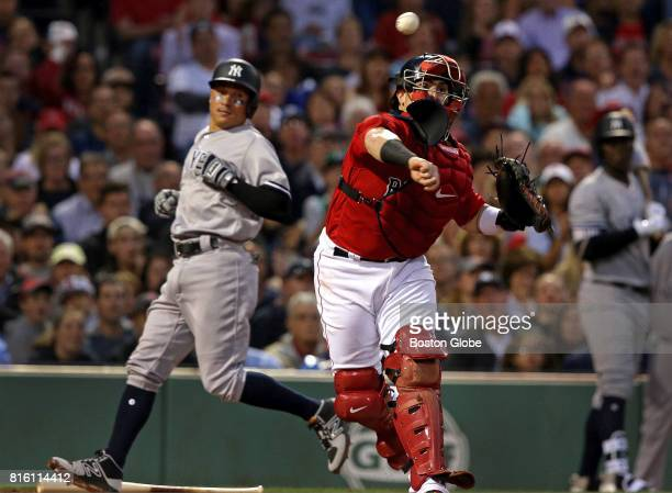 Boston Red Sox catcher Christian Vazquez gets the force at home plate on New York Yankees second baseman Ronald Torreyes and then fired to first base...