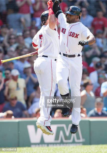 Boston Red Sox catcher Christian Vazquez left and first baseman Jackie Bradley Jr celebrate Bradley's solo home run in the fifth inning The Boston...