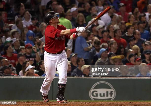 Boston Red Sox catcher Christian Vazquez watches his solo home run leave the park in the fifth inning The Boston Red Sox host the New York Yankees in...
