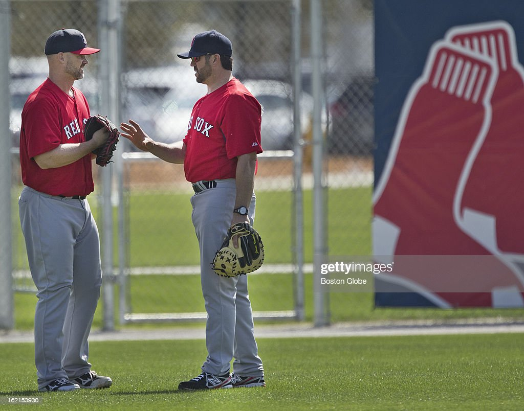 Boston Red Sox catcher David Ross talks to Jason Varitek, special assistant to the general manager, during spring training at JetBlue Park on Tuesday, Feb. 19, 2013.