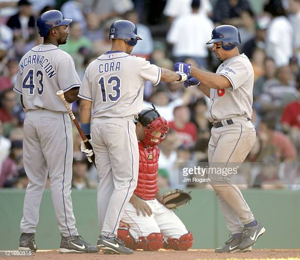 Boston Red Sox catcher Doug Mirabelli center looks as Los Angeles Dodgers' Olmedo Saenz right is being congratulated by his teammates after Saenz hit...