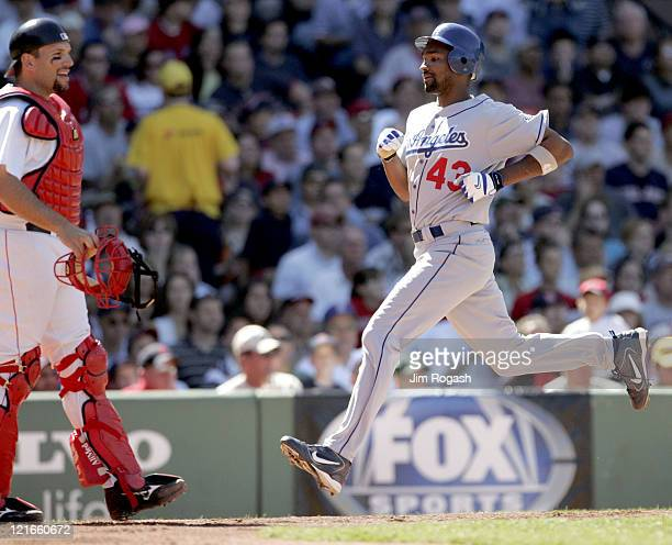 Boston Red Sox catcher Doug Mirabelli left watches the actions as Los Angeles Dodgers base runner Juan Encarnacion scores at Fenway Park in Boston...