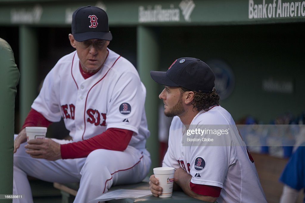 Boston Red Sox catcher Jarrod Saltalamacchia talks to Brian Butterfield (3rd base coach) in the dug out before they play the Minnesota Twins at Fenway Park on Tuesday, May 7, 2013.