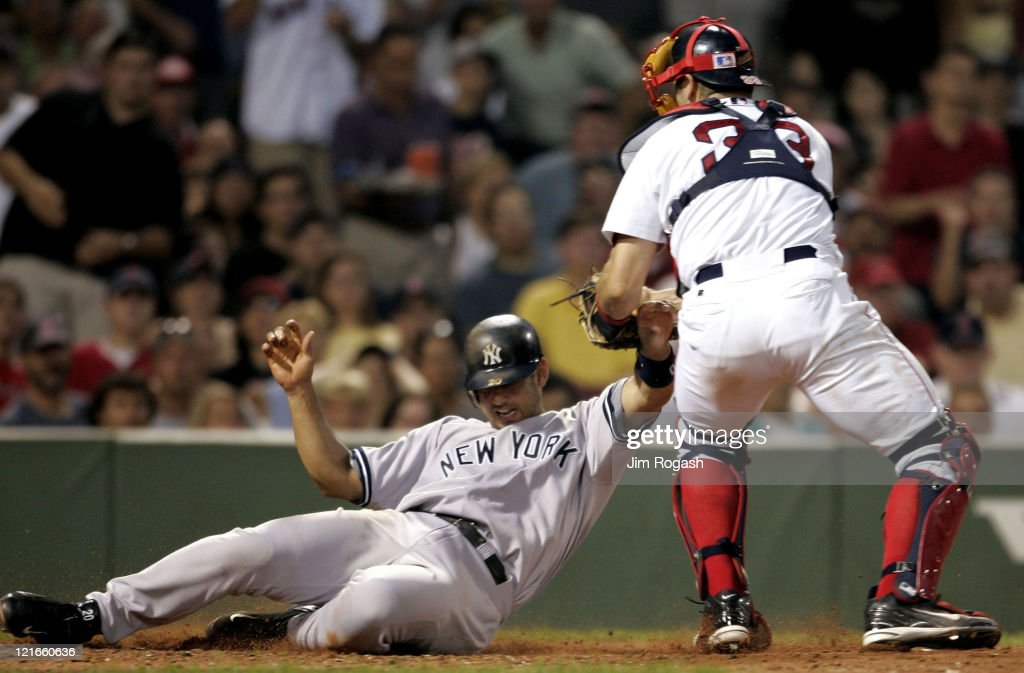 Boston Red Sox catcher <a gi-track='captionPersonalityLinkClicked' href=/galleries/search?phrase=Jason+Varitek&family=editorial&specificpeople=171480 ng-click='$event.stopPropagation()'>Jason Varitek</a>, right is late with the tag as New York Yankees' <a gi-track='captionPersonalityLinkClicked' href=/galleries/search?phrase=Jorge+Posada&family=editorial&specificpeople=202157 ng-click='$event.stopPropagation()'>Jorge Posada</a> scores at Fenway Park in Boston, Massachuesetts on July 23, 2004. The Yankees won 8-7.