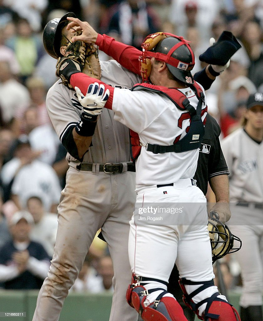 Boston Red Sox catcher Jason Varitek, right, strikes New York Yankees batter Alex Rodriguez at Fenway Park in Boston. The two fought after Rodriguez was hit by a pitch by Red Sox pitcher Bronson Arroyo. The Red Sox won, 11-10, with a 9th-inning game winning home run by Bill Mueller.