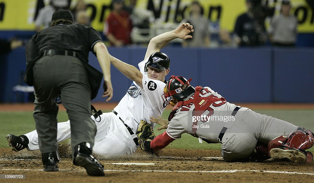 Boston Red Sox catcher Jason Varitek tags out Toronto Blue Jays Lyle Overbay at home plate at Rogers Centre in Toronto, Canada on September 24, 2006.