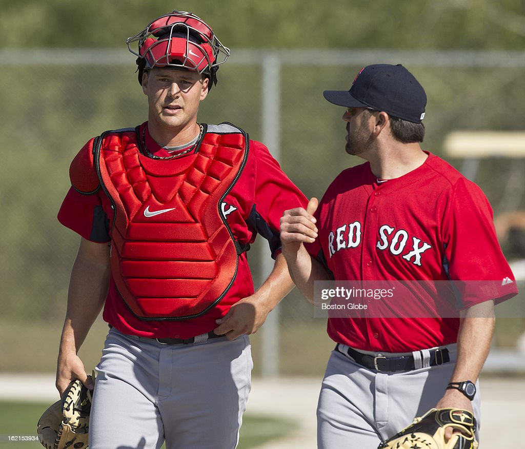 Boston Red Sox catcher Ryan Lavarnway works with Jason Varitek, special assistant to the general manager, during spring training at JetBlue Park on Tuesday, Feb. 19, 2013.