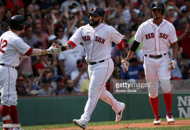 Boston Red Sox catcher Sandy Leon scores on a 2 run triple by Boston Red Sox center fielder Jackie Bradley Jr during the second inning The Boston Red...