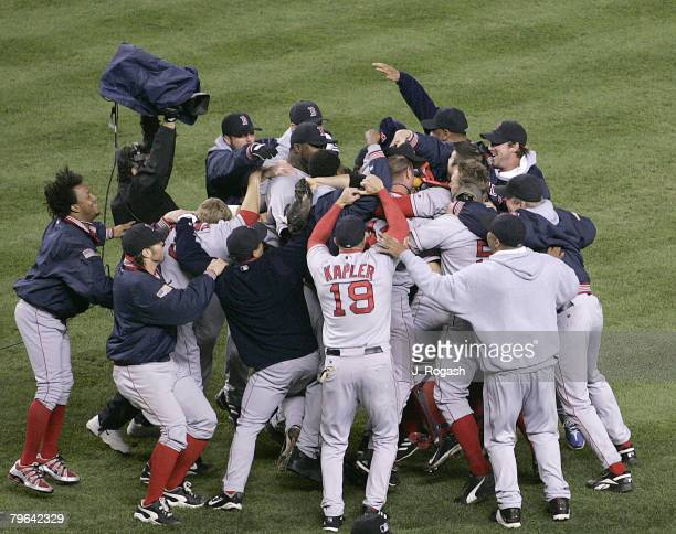 Boston Red Sox celebrate after defeating the New York Yankees in Game Seven 103 of the American League Championship Series Wednesday October 20 2004...