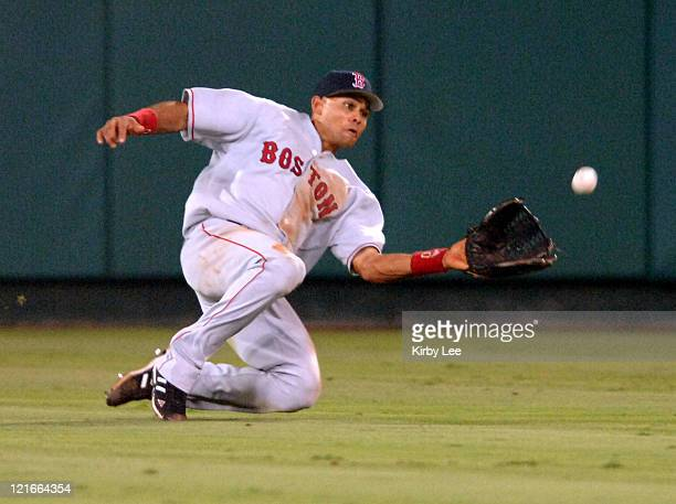 Boston Red Sox center field Coco Crisp makes a sliding catch in the fourth inning of 54 victory over the Los Angeles Angels of Anaheim at Angel...