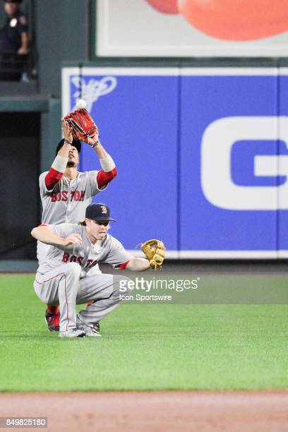 Boston Red Sox center fielder Jackie Bradley Jr catches a pop up over the top of second baseman Brock Holt during an MLB game between the Boston Red...
