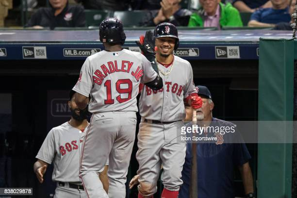 Boston Red Sox center fielder Jackie Bradley Jr is greeted by Boston Red Sox right fielder Mookie Betts after hitting a home run during the fourth...