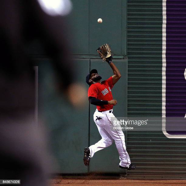 Boston Red Sox center fielder Jackie Bradley Jr makes a catch up against the wall of a long fly ball by Tampa Bay Rays center fielder Kevin Kiermaier...