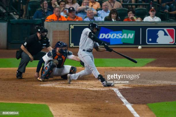 Boston Red Sox center fielder Jackie Bradley Jr makes contact in the third inning during game one of the American Division League Series between the...