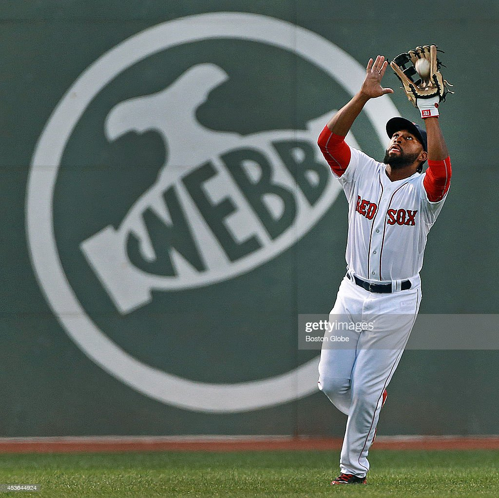 Boston Red Sox center fielder <a gi-track='captionPersonalityLinkClicked' href=/galleries/search?phrase=Jackie+Bradley+-+Jugador+de+b%C3%A9isbol&family=editorial&specificpeople=15049465 ng-click='$event.stopPropagation()'>Jackie Bradley</a>, Jr, makes the catch on a second inning fly ball off the bat of the Astros Jake Marisnick (not pictured). The Boston Red Sox hosted the Houston Astros in an inter league MLB game at Fenway Park.