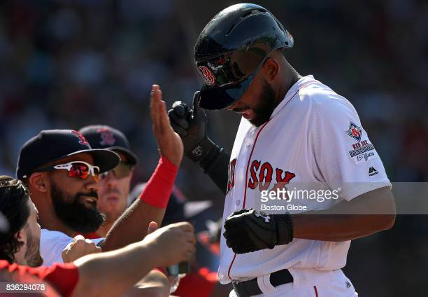 Boston Red Sox center fielder Jackie Bradley Jr receives a round of high fives after his RBI single in the sixth inning brought on a Yankees pitching...
