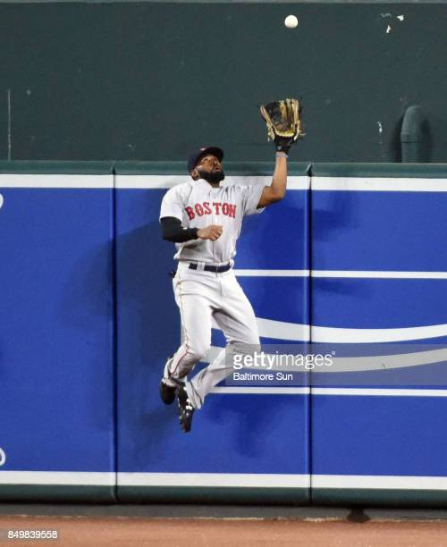 Boston Red Sox center fielder Jackie Bradley times his jump perfectly to rob a potential home run from the Baltimore Orioles' Chris Davis in the...