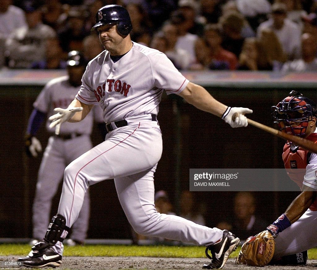 Boston Red Sox Dante Bichette follows through with his swing on a two-run home run hit off of Cleveland Indians pitcher Chuck Finley in the second inning on 12, September, 2000 at Jacobs Field in Cleveland, OH. Boston defeated Cleveland 8-6. (ELECTRONIC IMAGE) AFP PHOTO/David MAXWELL