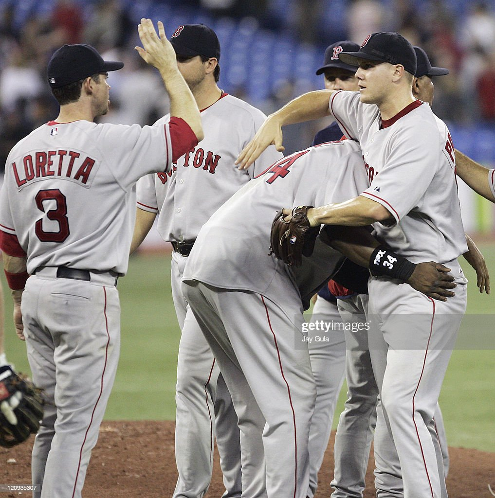 Boston Red Sox David Ortiz hands out unique congratulations to P Jonathan Papelbon after he recorded his 19th save in Boston's 86 victory over the...