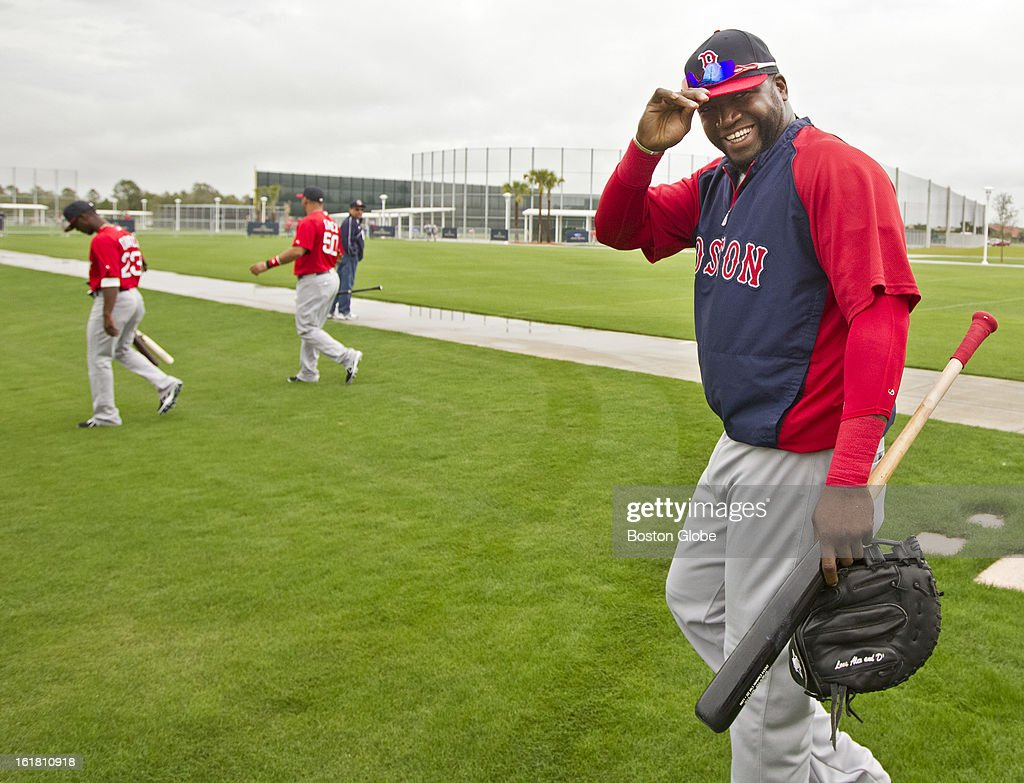 Boston Red Sox David Ortiz heads out to the field during the first full squad team workout. Day four of spring training at the Red Sox training facilities at JetBlue Park on Friday, Feb. 15, 2013.