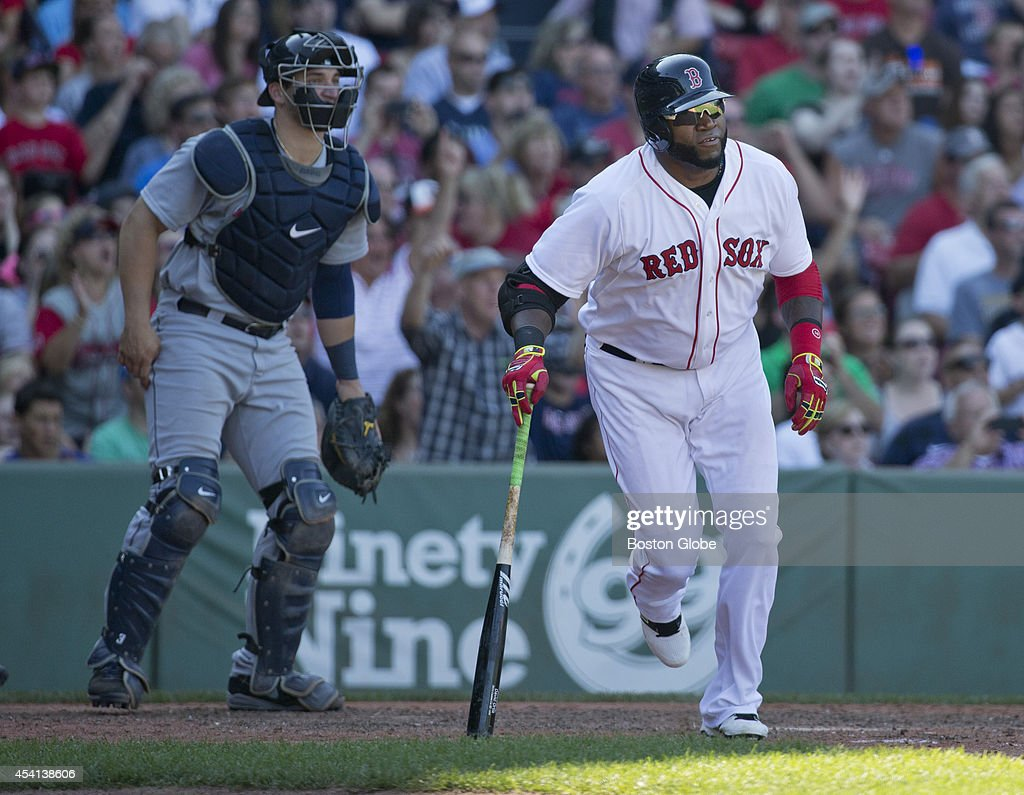 Boston Red Sox David Ortiz limping to first base after getting a base hit against the Seattle Mariners during sixth inning action at Fenway Park on Sunday, August 24, 2014.