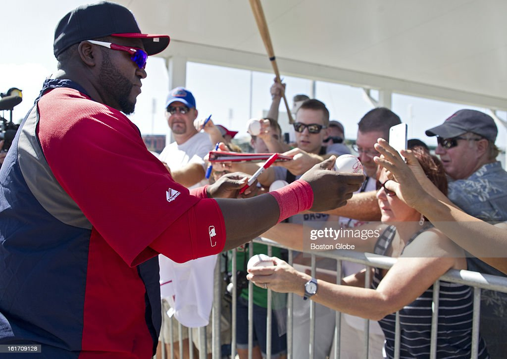 Boston Red Sox David Ortiz signs his autograph for lucky fans after day two of spring training at the Red Sox training facilities at JetBlue Park on Wednesday, Feb. 13, 2013.