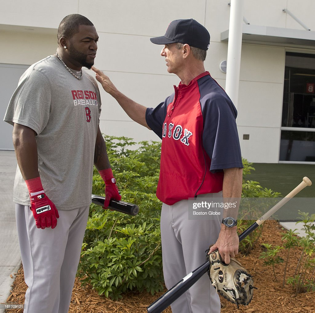 Boston Red Sox David Ortiz talks to Goose Gregson, the Red Sox Latin American pitching coordinator, before heading to the batting cage. Day two of spring training at the Red Sox training facilities at JetBlue Park on Wednesday, Feb. 13, 2013.