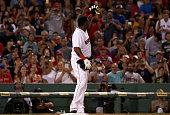 Boston Red Sox designated hitter David Ortiz acknowledges the fans with a wave after taking third on a throwing error during the sixth inning of a...