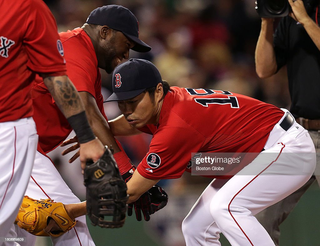 Boston Red Sox designated hitter David Ortiz (#34) and Boston Red Sox relief pitcher Koji Uehara (#19) go through their ritual as they celebrate the win. The Boston Red Sox take on the New York Yankees in Game one of a three game series at Fenway Park.