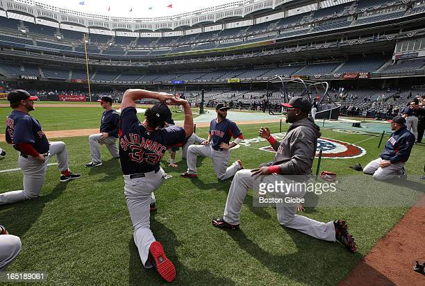 Boston Red Sox designated hitter David Ortiz Boston Red Sox second baseman Dustin Pedroia and team go through their pregame stretching as they...