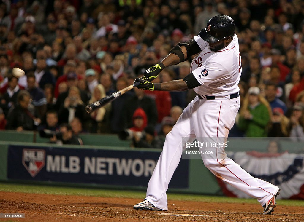 Boston Red Sox designated hitter David Ortiz (#34) hits a Grand Slam to tie the game at 5-5 in the eighth inning. The Boston Red Sox hosted the Detroit Tigers in game two of the American League Championship Series at Fenway Park.