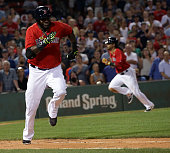 Boston Red Sox designated hitter David Ortiz hustles up the first base line as Boston Red Sox center fielder Michael Martinez was forced out at home...