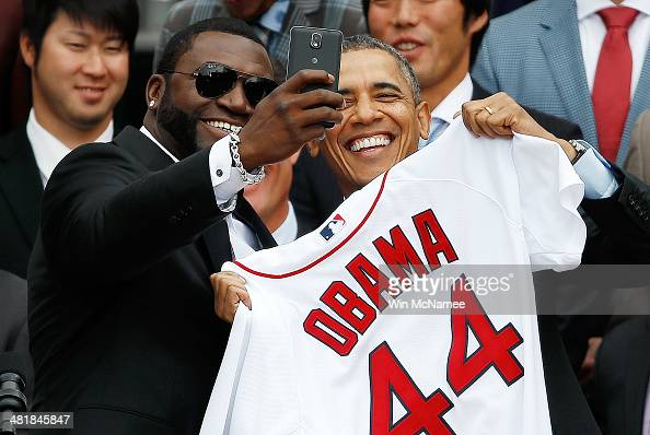 Boston Red Sox designated hitter David Ortiz poses for a 'selfie' with US President Barack Obama during a ceremony on the South Lawn of the White...