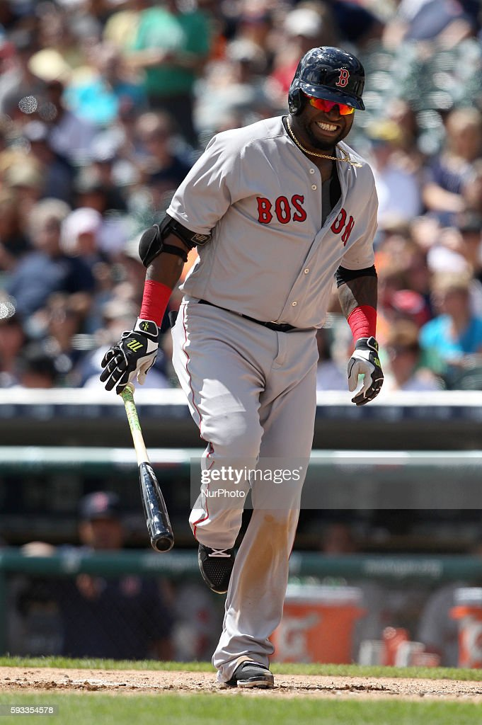 Boston Red Sox designated hitter David Ortiz reacts after being hit by a ball during the fourth inning of a baseball game against the Detroit Tigers...