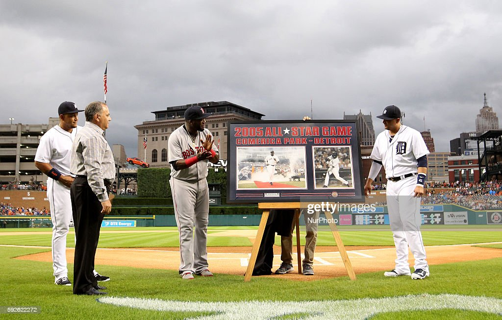 Boston Red Sox designated hitter David Ortiz reacts to a gift of framed photos during a pregame ceremony in honor of his retirement during a baseball...